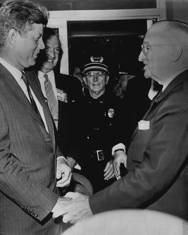 Description of . Former President Harry S. Truman shakes hands with Sen. John F. Kennedy, the Democratic presidential nominee, at the Truman Library on Aug. 21, 1960, shortly before the senator's private conference with Truman. Sen. Stuart Symington of Missouri is standing at Kennedy's left. Associated Press file