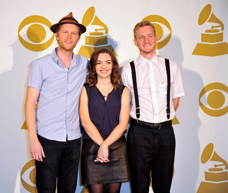 Description of . The Lumineers, from left, Wesley Schultz, Neyla Pekarek and Jeremiah Fraites, pose for a photo backstage at the Grammy Nominations Concert Live! at Bridgestone Arena on Wednesday, Dec. 5, 2012, in Nashville, Tenn. (Photo by Donn Jones/Invision/AP)