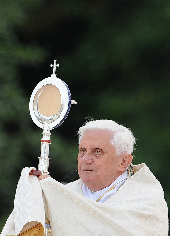 Description of . A file picture taken on September 14, 2008 shows Pope Benedict XVI holding a monstrance during a ceremony following an eucharistic procession at La Prairie in Lourdes. Benedict XVI announced on February 11, 2013 he will resign on February 28 because his age prevented him from carrying out his duties, an unprecedented move in the modern history of the Catholic Church. ALBERTO PIZZOLI/AFP/Getty Images