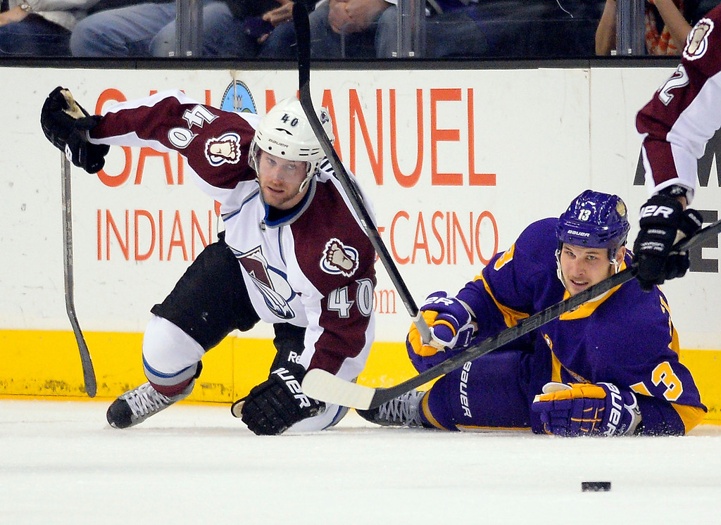 Description of . Colorado Avalanche center Mark Olver, left, and Los Angeles Kings left wing Kyle Clifford falls to the ice during the first period of their NHL hockey game, Saturday, Feb. 23, 2013, in Los Angeles. The Lakers won 111-107. (AP Photo/Mark J. Terrill)