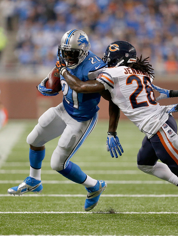 Description of . DETROIT, MI - SEPTEMBER 29:  Tim Jennings #26 of the Chicago Bears pushes Reggie Bush #21 of the Detroit Lions out of bounds in the first quarter at Ford Field on September 29, 2013 in Detroit, Michigan. (Photo by Gregory Shamus/Getty Images)
