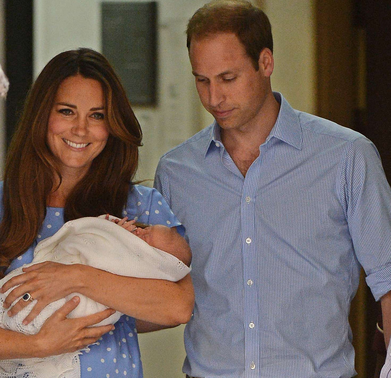 Description of . Prince William and Catherine, Duchess of Cambridge show their new-born baby boy to the world\'s media, leaving the Lindo Wing of St Mary\'s Hospital in London on July 23, 2013. The baby was born on Monday afternoon weighing eight pounds six ounces (3.8 kilogrammes). The baby, titled His Royal Highness, Prince (name) of Cambridge, is directly in line to inherit the throne after Charles, Queen Elizabeth II\'s eldest son and heir, and his eldest son William. AFP PHOTO / LEON NEALLEON NEAL/AFP/Getty Images