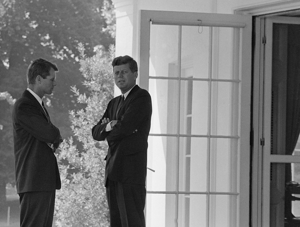 Description of . Kennedy confers with his brother, Attorney General Robert F. Kennedy, left,  at the White House on Oct. 1, 1962, as military tensions built between the U.S. and Soviet Union to become Cuban missile crisis later that month. Associated Press file