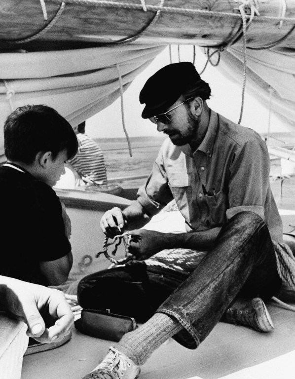 Description of . Folk singer Pete Seeger aboard his brainchild, the sloop Clearwater, cruising on Aug. 12, 1969, down from Massachusetts to N.Y., on Madrid voyage. (AP Photo)
