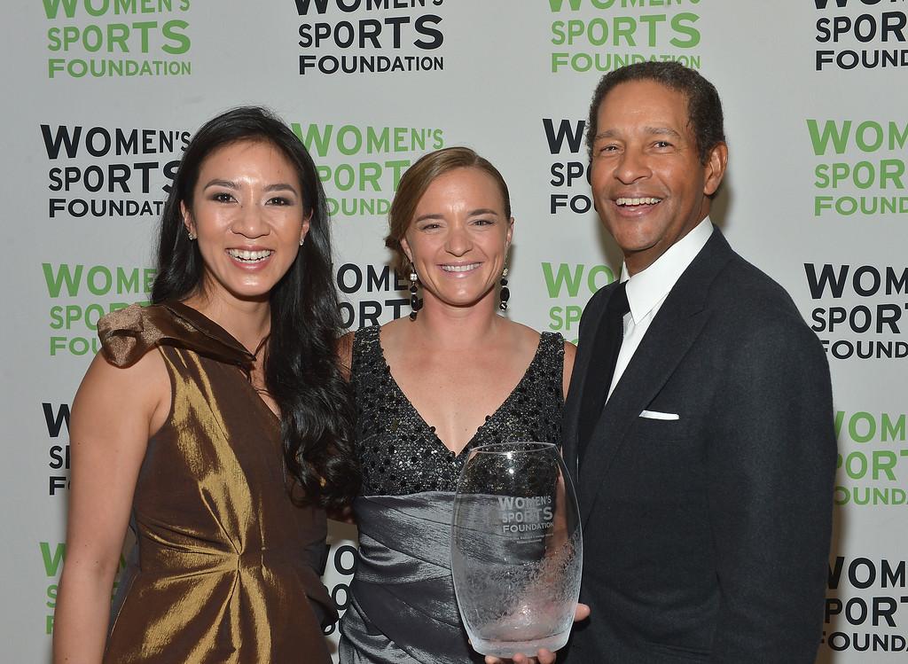 Description of . NEW YORK, NY - OCTOBER 16:  Michelle Kwan (L) and Bryant Gumbel (R) pose with Paratriathlete Melissa Stockwell (C) with the Wilma Rudolph Courage Award during the 34th annual Salute to Women In Sports Awards at Cipriani, Wall Street on October 16, 2013 in New York City.  (Photo by Mike Coppola/Getty Images for the Women's Sports Foundation)