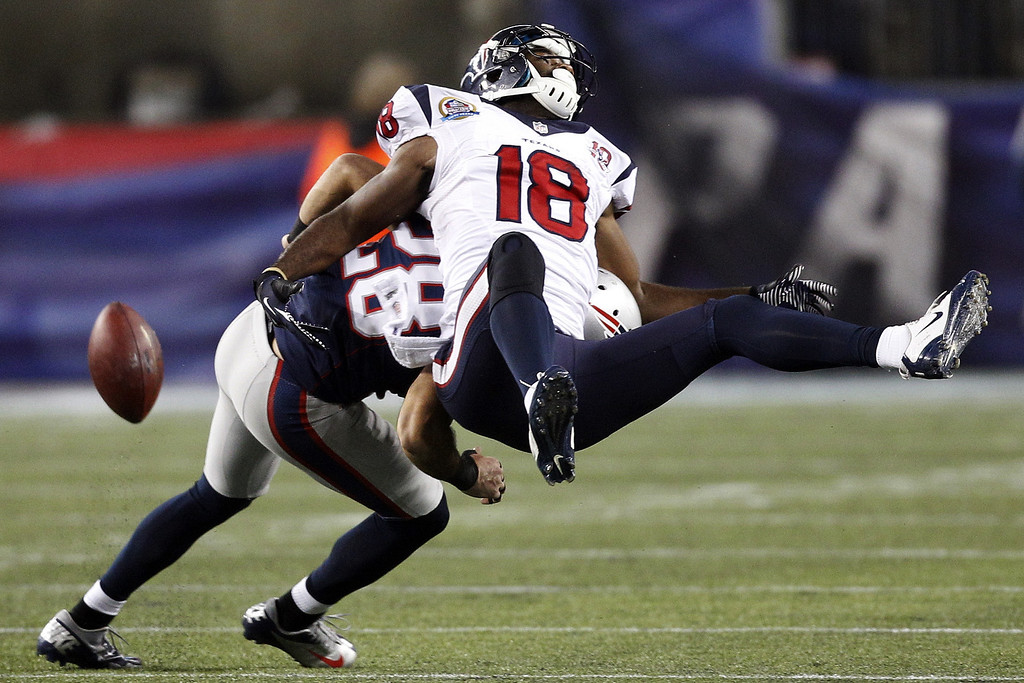 Description of . New England Patriots strong safety Steve Gregory (28) breaks up a pass intended for Houston Texans wide receiver Lestar Jean (18) during the second quarter of an NFL football game in Foxborough, Mass., Monday, Dec. 10, 2012. (AP Photo/Stephan Savoia)