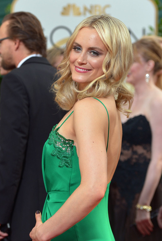 Description of . Taylor Schilling arrives at the 71st annual Golden Globe Awards at the Beverly Hilton Hotel on Sunday, Jan. 12, 2014, in Beverly Hills, Calif. (Photo by John Shearer/Invision/AP)