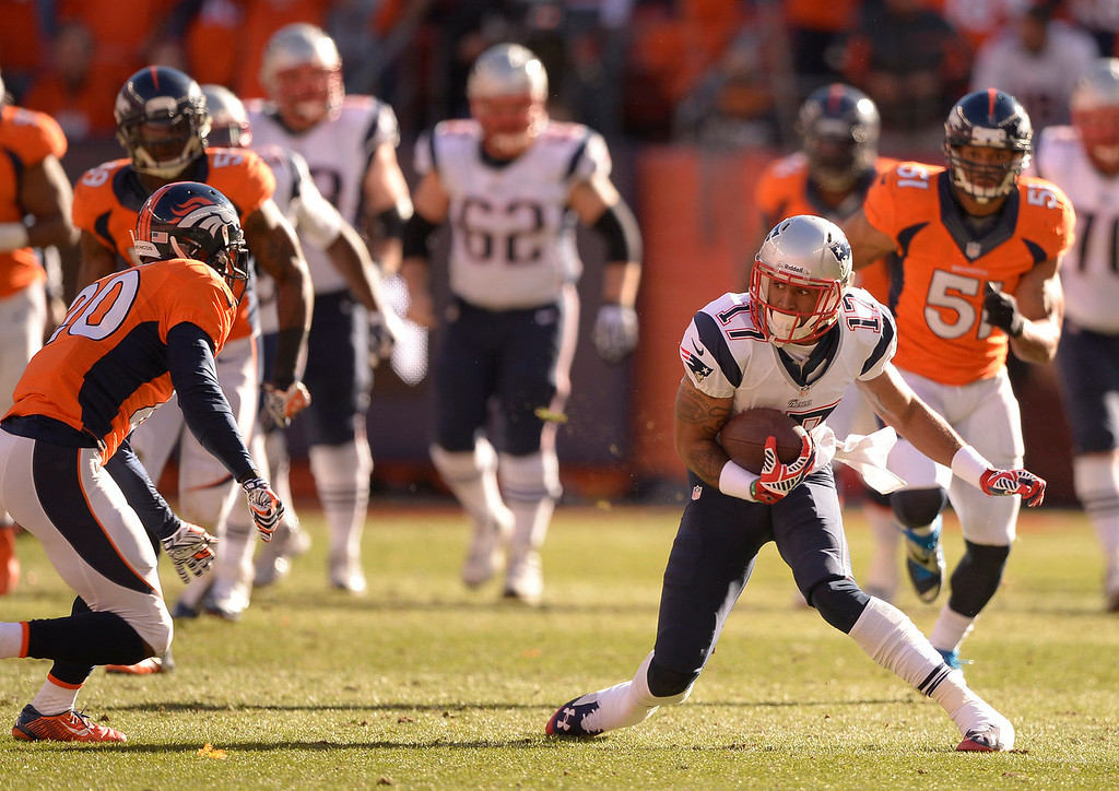 Description of . New England Patriots wide receiver Aaron Dobson (17) has second thoughts as Denver Broncos free safety Mike Adams (20) comes up on him during the second quarter. The Denver Broncos vs. The New England Patriots in an AFC Championship game  at Sports Authority Field at Mile High in Denver on January 19, 2014. (Photo by John Leyba/The Denver Post)
