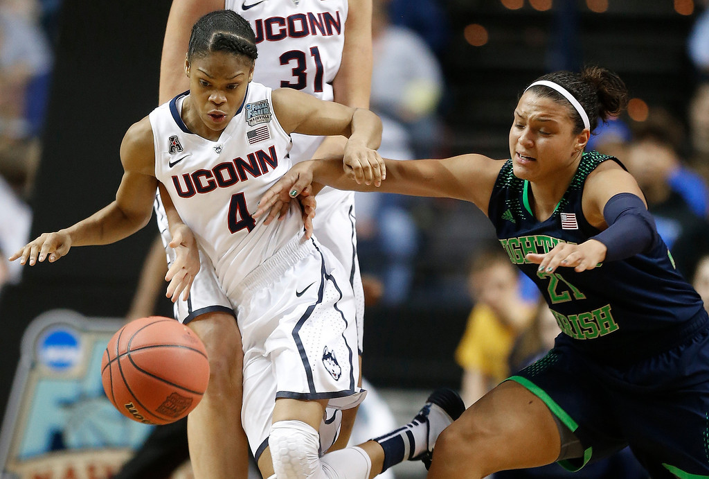 Description of . Notre Dame guard Kayla McBride (21) and Connecticut guard Moriah Jefferson (4) vie for a loose ball during the second half of the championship game in the Final Four of the NCAA women's college basketball tournament, Tuesday, April 8, 2014, in Nashville, Tenn. (AP Photo/John Bazemore)