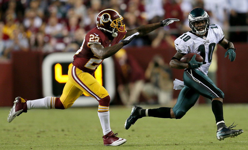 Description of . Wide receiver DeSean Jackson #10 of the Philadelphia Eagles runs after a catch against running back Chris Thompson #25 of the Washington Redskins in the second quarter at FedExField on September 9, 2013 in Landover, Maryland.  (Photo by Rob Carr/Getty Images)
