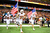 Luke  Utley #37 and Alex King #15 of the University of Texas Longhorns lead their team onto the field for a game against the Oregon State Beavers during the Valero Alamo Bowl at the Alamodome on December 29, 2012 in San Antonio, Texas.  (Photo by Stacy Revere/Getty Images)
