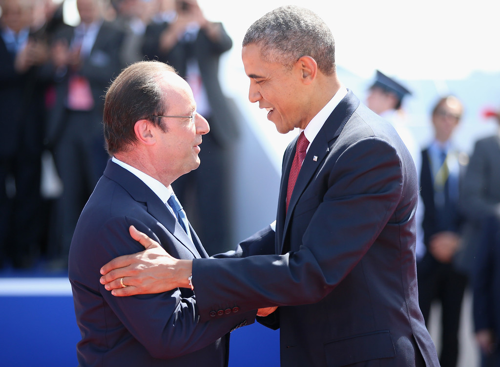 Description of . President Barak Obama of the United States  greets President Francois Hollande of France at a Ceremony to Commemorate D-Day 70 on Sword Beach on June 6, 2014 in Ouistreham, France.  (Photo by Chris Jackson/Getty Images)