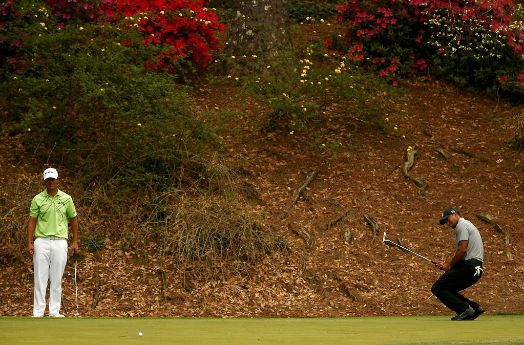 Description of . Tiger Woods of the U.S. (R) reacts to missing a birdie putt on the 12th green as John Piercy of the U.S. watches during first round play in the 2013 Masters golf tournament at the Augusta National Golf Club in Augusta, Georgia, April 11, 2013.   REUTERS/Mark Blinch
