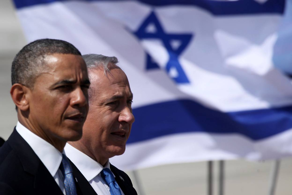 Description of . U.S. President Barack Obama (L) is greeted by Israeli Prime Minister Benjamin Netanyahu during an official welcoming ceremony on his arrival at Ben Gurion International Airport on March, 20, 2013 near Tel Aviv, Israel. (Photo by Marc Israel Sellem-Pool/Getty Images)