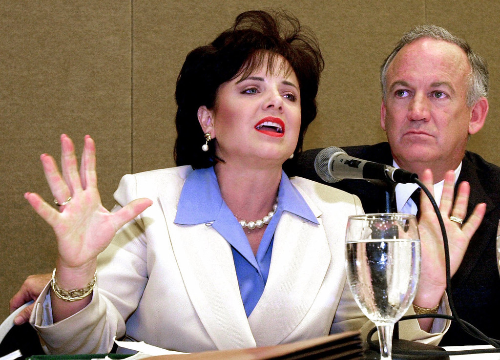 . Patsy Ramsey answers a question during a press conference in Atlanta Wednesday, May 24, 2000 about her lie-detector examination concerning the murder of her daughter JonBenet as her husband John Ramsey looks on at right. The Ramseys presented lie-detector test results they said showed they were not \'attempting deception\' when they denied killing their 6-year-old daughter. (AP Photo/Ric Feld)