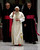 Pope Benedict XVI, center, delivers his blessing in between his personal aide Georg Gaenswein, right, and Monsignor Leonardo Sapienza during his weekly general audience at the Vatican, Wednesday, Dec. 12, 2012. In perhaps the most drawn out Twitter launch ever, Pope Benedict XVI pushed the button on a tablet brought to him at the end of his general audience Wednesday. It read: 