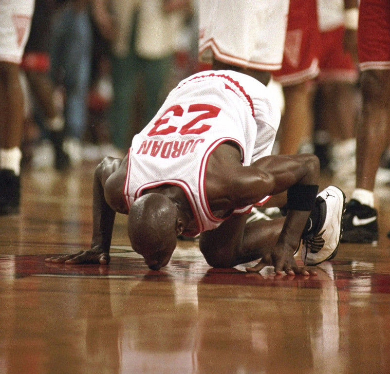 Description of . Former Chicago Bulls' star Michael Jordan kisses the basketball floor of the Chicago Stadium as he leaves it for the last time, in this September 9, 1994 photo.  The stadium is due to be torn down.  Jordan,  the greatest player in NBA history and the most popular athlete since Muhammad Ali is expected to announce his retirement Wednesday  at a news conference in Chicago, a source with close ties to the NBA told The Associated Press on Monday night Jan. 11, 1999. (AP Photo/Barry Jarvinen)