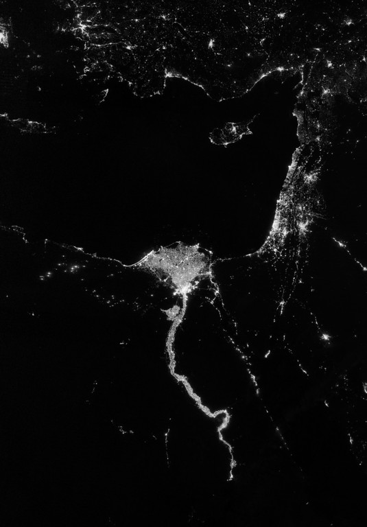"Description of . In this image obtained from NASA, on October 13, 2012, the Visible Infrared Imaging Radiometer Suite (VIIRS) on the Suomi NPP satellite captured this nighttime view of the Nile River Valley, its Delta (C), the Sinai (C-R) and the rest of the Middle East. This image is from the VIIRS ""day-night band,"" which detects light in a range of wavelengths from green to near-infrared and uses filtering techniques to observe signals such as gas flares, auroras, wildfires, city lights, and reflected moonlight AFP PHOTO / NASA"