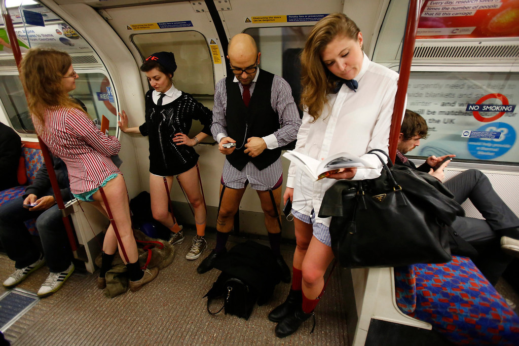 Description of . People take part in a No Pants Day 2014 flash mob on the London Underground, in London, Britain, 12 January 2014. The event is organized by Improv Everywhere and takes place in many cities across the world. The goal for the participants is to get on public transport dressed in normal winter clothes, but without pants while keeping a straight face.  EPA/TAL COHEN