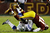 LANDOVER, MD - DECEMBER 30:  Madieu Williams #41 of the Washington Redskins tackles Dwayne Harris #17 of the Dallas Cowboys after a pass reception in the second quarter at FedExField on December 30, 2012 in Landover, Maryland.  (Photo by Rob Carr/Getty Images)