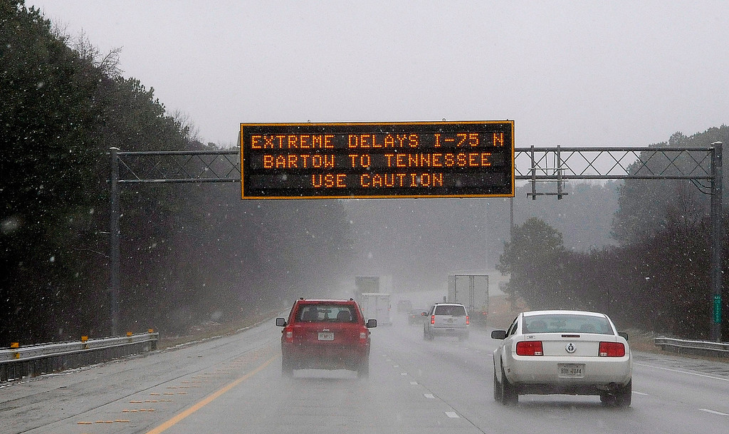"Description of . A Georgia transportation sign warns motorists on Interstate 75 on Tuesday, Feb. 11, 2014, in Kennesaw, Ga., about 20 miles north of metro Atlanta.  A winter snow storm is  blowing into Georgia in what the National Weather Service predicted to be ""an event of historical proportions.\""  (AP Photo/David Tulis)"