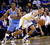 Golden State Warriors' Stephen Curry (30) dribbles past Denver Nuggets' Andre Miller (24) during the first half of an NBA basketball game in Oakland, Calif., Thursday, Nov. 29, 2012. (AP Photo/Marcio Jose Sanchez)