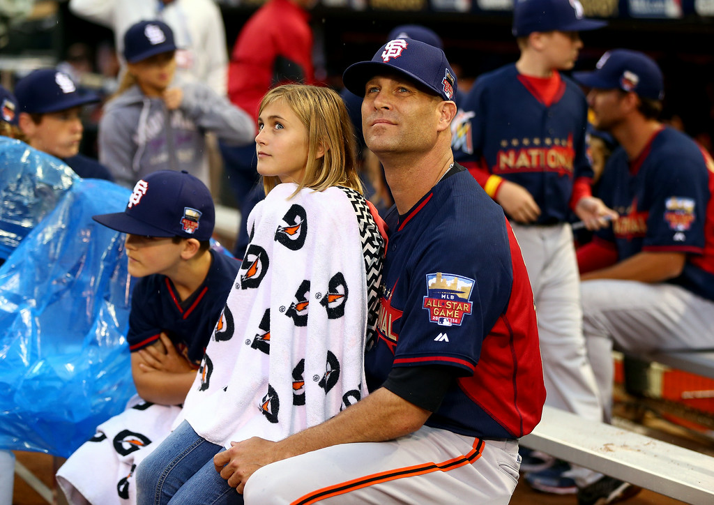 Description of . National League All-Star Tim Hudson #17 of the San Francisco Giants with his daughter during the Gillette Home Run Derby at Target Field on July 14, 2014 in Minneapolis, Minnesota.  (Photo by Elsa/Getty Images)