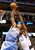 Denver Nuggets center JaVale McGee (L) beats Dallas Mavericks forward Elton Brand to a rebound during the first half of their NBA basketball game in Dallas, Texas, December 28, 2012.  REUTERS/Mike Stone