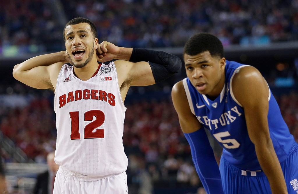 Description of . Wisconsin guard Traevon Jackson (12)and Kentucky guard Andrew Harrison (5) pause between plays during the second half of the NCAA Final Four tournament college basketball semifinal game Saturday, April 5, 2014, in Arlington, Texas. (AP Photo/David J. Phillip)