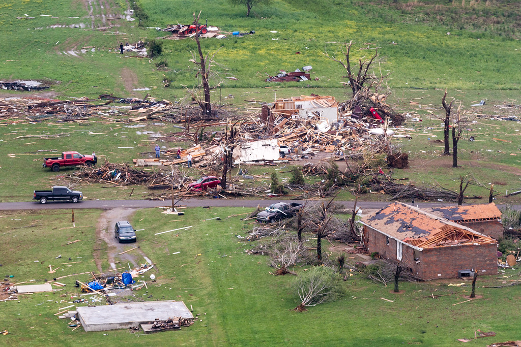 Description of . This aerial photo show homes damaged by a tornado near Fayetteville, Tenn.  Gov. Bill Haslam visited the area near the Alabama line that suffered heavy damage and two fatalities during Monday's storms. (AP Photo/Erik Schelzig)