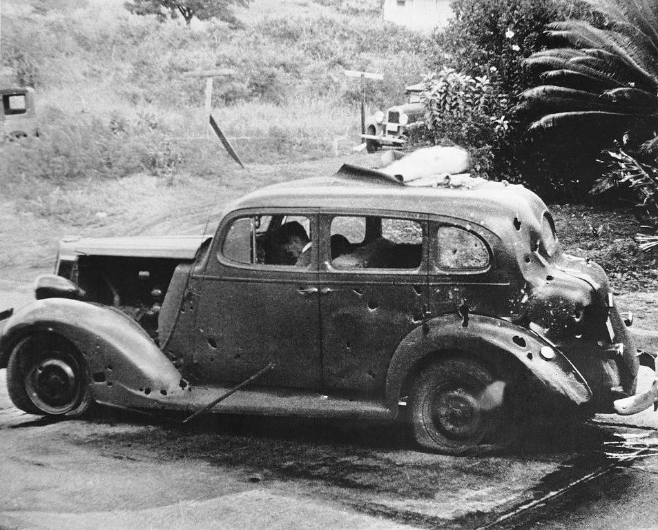 Description of . In this photo provided by the U.S. Navy, eight miles from Pearl Harbor, shrapnel from a Japanese bomb riddled this car and killed three civilians in the attack of Dec. 7, 1941. Two of the victims can be seen in the front seat. The Navy reported there was no nearby military objective. (AP Photo/U.S. Navy)