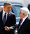 U.S. President Barack Obama gestures while walking next to Palestinian President Mahmoud Abbas (R) before reviewing troops during an arrival ceremony at the Muqata Presidential Compound in the West Bank City of Ramallah March 21, 2013.     REUTERS/Larry Downing