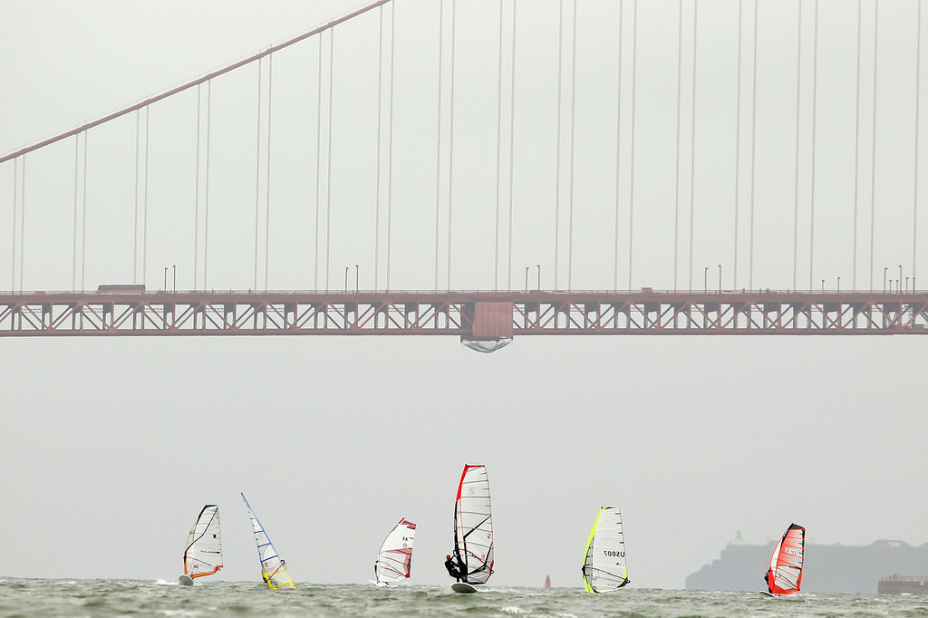Description of . Athletes sail near the Golden Gate Bridge during day 1 of the US Windsurfing National Championships hosted by the St. Francis Yacht Club on July 20, 2010 in San Francisco, California.  (Photo by Ezra Shaw/Getty Images)