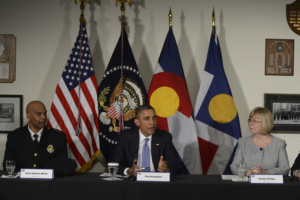 Description of . DENVER, CO. - APRIL 03: President Barack Obama is flanked by Denver Police Chief, Robert White, left, and Sandy Phillips during a round table discussion at the Denver Police Academy in Denver, CO April 03, 2013. The meeting took place before a forum with law enforcement officials and community leaders.   (Photo By Craig F. Walker/The Denver Post)
