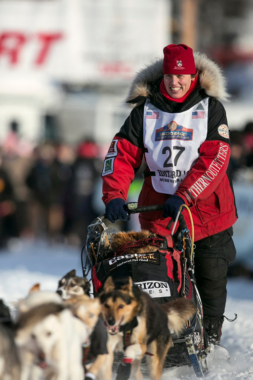 Description of . Aliy Zirkle leaves the start gate at the re-start of the Iditarod dog sled race in Willow, Alaska March 3, 2013. Zirkle finished second place in 2012 and is considered a top contender for the 2013 race.  REUTERS/Nathaniel Wilder