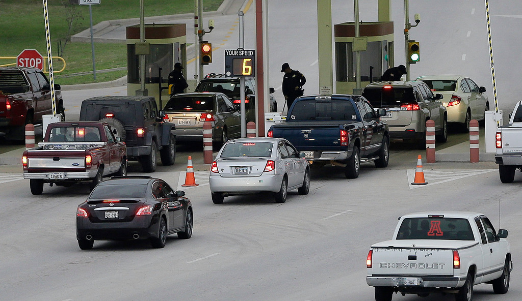 Description of . Security check vehicles as they enter Fort Hood's main gate, Thursday, April 3, 2014, in Fort Hood, Texas.  (AP Photo/Eric Gay)