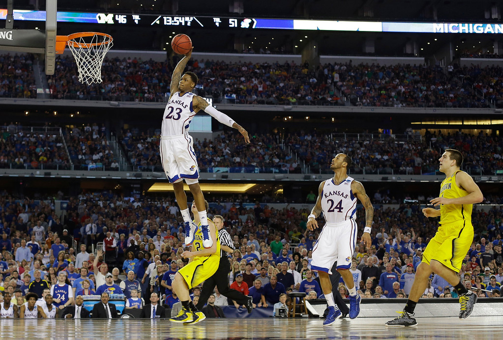 Description of . Kansas guard Ben McLemore (23) dunks against Michigan during the second half of a regional semifinal game in the NCAA college basketball tournament, Friday, March 29, 2013, in Arlington, Texas. (AP Photo/Tony Gutierrez)