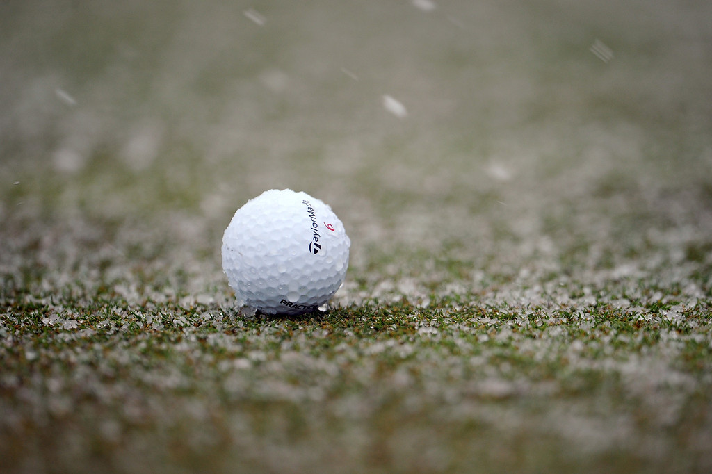 Description of . MARANA, AZ - FEBRUARY 20:  A detail of a Taylormade ball is seen on the course as snow falls which caused play to be suspended during the first round of the World Golf Championships - Accenture Match Play at the Golf Club at Dove Mountain on February 20, 2013 in Marana, Arizona.  (Photo by Stuart Franklin/Getty Images)