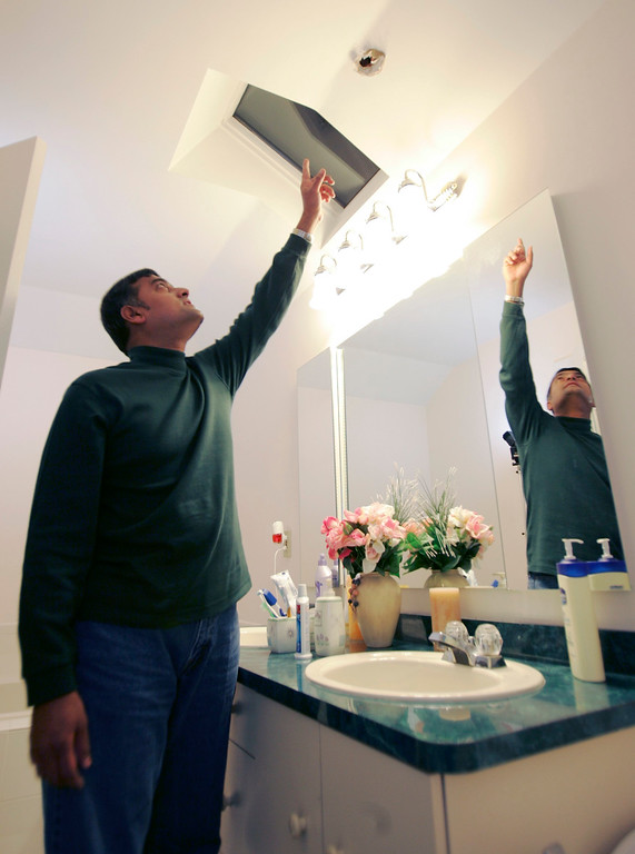 Description of . Srinivasan Nageswaran points to a hole in the ceiling of his bathroom in Freehold Township, N.J., Tuesday, Jan. 9, 2007, that was caused by a meteorite. Nageswaran and his wife, Shankari, have not decided what to do yet with the small meteorite that crashed through  their roof on Jan. 2, 2007. (AP Photo/Mike Derer)