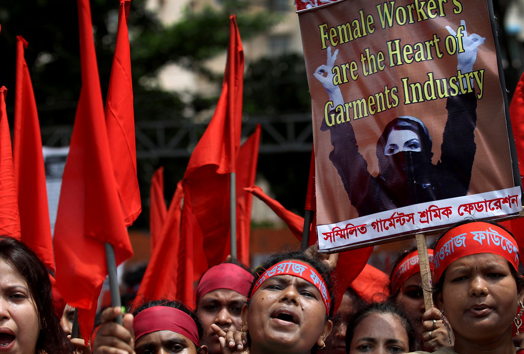 Description of . Women protesters shout slogans during a May Day rally on Wednesday May 1, 2013 in Dhaka, Bangladesh. Thousands of workers paraded through central Dhaka on May Day to demand safer working conditions and the death penalty for the owner of a building housing garment factories that collapsed last week in the country's worst industrial disaster, killing at least 402 people and injuring 2,500. (AP Photo/Wong Maye-E)