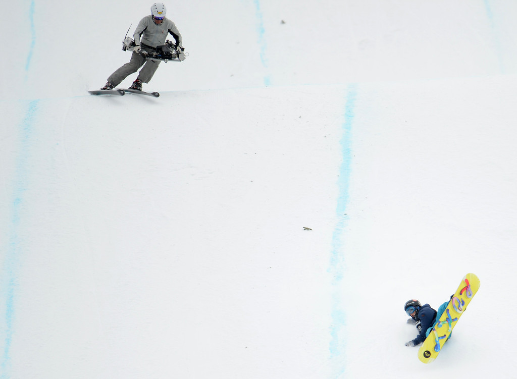 Description of . ASEN, CO. - JANUARY 26:  Kjersti Oestgaard Buaas crashes on her last jump during the Women's Snowboard Slopestyle Final, January 26, 2013, at the 2013 Winter X Games at Buttermilk Mountain in Aspen. (Photo By RJ Sangosti / The Denver Post)