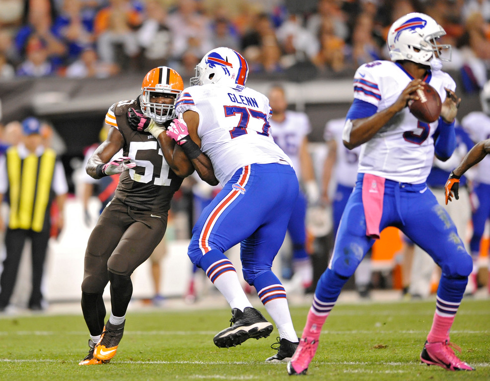 Description of . Cleveland Browns outside linebacker Barkevious Mingo (51) tries to get past Buffalo Bills tackle Cordy Glenn (77) to quarterback EJ Manuel in the second quarter of an NFL football game Thursday, Oct. 3, 2013, in Cleveland. (AP Photo/David Richard)