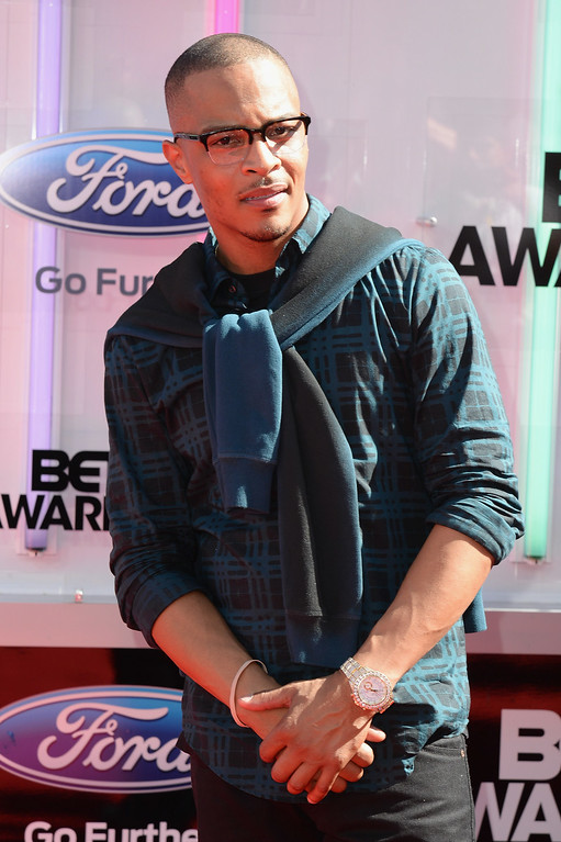 Description of . Rapper T.I. attends the BET AWARDS '14 at Nokia Theatre L.A. LIVE on June 29, 2014 in Los Angeles, California.  (Photo by Earl Gibson III/Getty Images for BET)