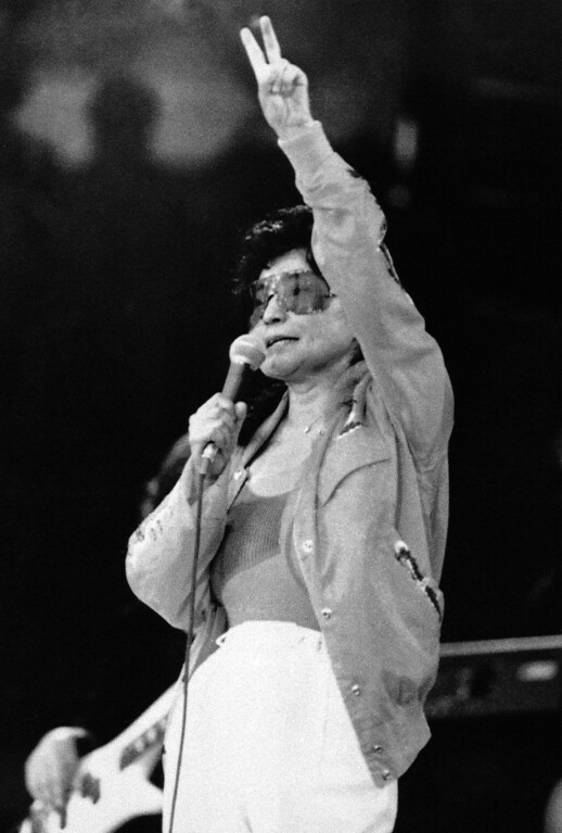 Description of . Yoko Ono, widow of former Beatle John Lennon is performing on the stage of the VUB (Free Brussels University) in Brussels on Friday, March 1, 1986. She started her European tour in Brussels with future stops in Holland, Poland, West Germany, Ireland and England. (AP Photo/Loyaard)