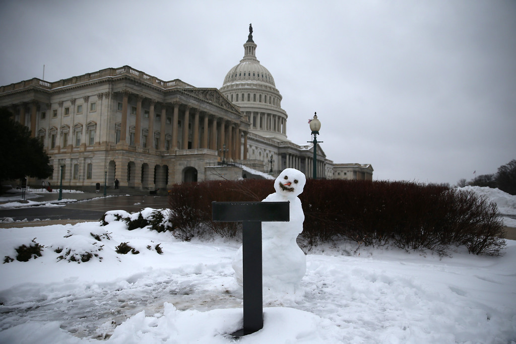 Description of . A snowman sits where Congressman sometimes hold their news conferences on the House side of the U.S. Capitol, on February 13, 2014 in Washington, DC. The east coast was hit with a winter snowstorm with parts of the Washington area receiving up to 11 inches of snow.  (Photo by Mark Wilson/Getty Images)