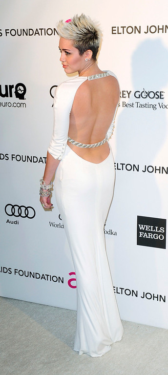 Description of . Performer Miley Cyrus arrives at the 2013 Elton John AIDS Foundation Oscar Party in West Hollywood, California, February 24, 2013.  REUTERS/Gus Ruelas