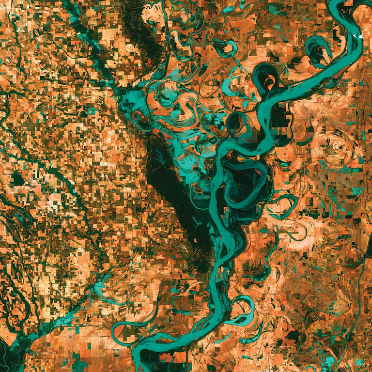 Description of . Meandering Mississippi, United States Graceful swirls and whorls of the Mississippi River encircle fields and pastures in this Landsat 7 image from 2003. Oxbow lakes and cutoffs accompany the meandering river south of Memphis, Tennessee, on the border between Arkansas and Mississippi. The mighty Mississippi is the largest river system in North America and forms the second largest watershed in the world.   NASA