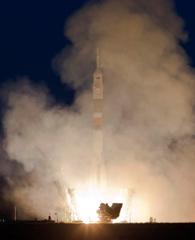 Description of . The Soyuz TMA-07M spacecraft carrying the International Space Station (ISS) crew of U.S. astronaut Thomas Marshburn, Russian cosmonaut Roman Romanenko and Canadian astronaut Chris Hadfield blasts off from its launch pad at the Baikonur cosmodrome December 19, 2012. REUTERS/Shamil Zhumatov