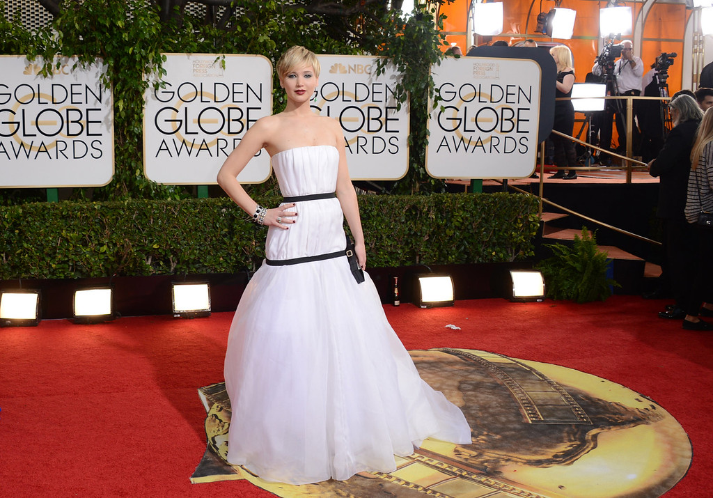 Description of . Jennifer Lawrence arrives at the 71st annual Golden Globe Awards at the Beverly Hilton Hotel on Sunday, Jan. 12, 2014, in Beverly Hills, Calif. (Photo by Jordan Strauss/Invision/AP)