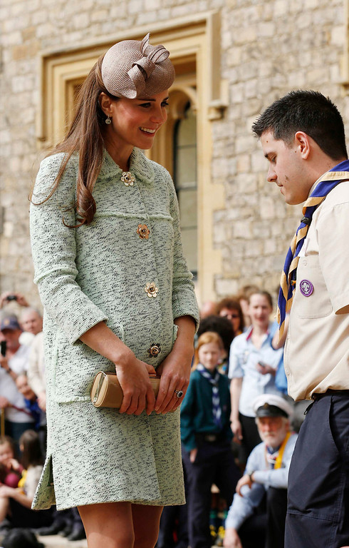 Description of . Britain\'s Catherine, Duchess of Cambridge (L) attends the National Review of Queen\'s Scouts at Windsor Castle in Berkshire on April 21, 2013. The event celebrates the achievements of young people and young adults who have achieved the Queen\'s Scout award. This award is gained by carrying out regular community service for a year, learning new skills, completing a four day expedition in unknown terrain; taking part in a residential project and then sharing what has been learned with their peers.  OLIVIA HARRIS/AFP/Getty Images)